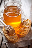 Crackers and honey Stock Images