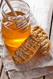 Crackers and honey Stock Photo