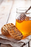 Crackers and honey Stock Photography