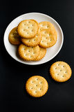 Crackers. Isolate on black background Stock Photos