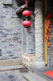 Crackers,lanterns and pillar. Firecracker decorations,a red lantern and the stone pillar embossed with a design of dragon,in the backyard of a holiday inn,at Royalty Free Stock Image