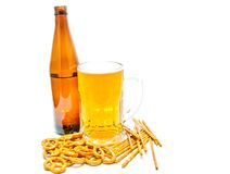 Crackers and light beer. Salted crackers and light beer closeup on white Royalty Free Stock Photos