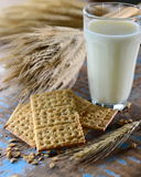 Crackers and milk glass Stock Photos