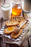 Crackers, milk and honey Stock Photos