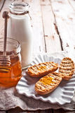 Crackers, milk and honey Stock Images