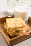 Crackers and milk in wooden tray Royalty Free Stock Photo