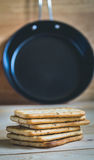 Crackers and pan. Pile of crackers and pan- muted color and split toning effect Stock Photo
