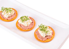 Crackers with pate, cheese cream and dill on a plate. White background Stock Images