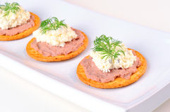 Crackers with pate, cheese cream and dill on a plate. White background Royalty Free Stock Photo