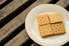 Crackers on a plate. With wood background Royalty Free Stock Photo