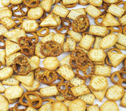 Crackers and pretzels. A wonderful occupation watching TV Royalty Free Stock Photography