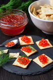 Crackers and red caviar Stock Photography