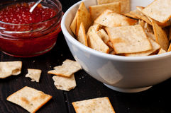 Crackers and red caviar Stock Photo