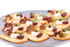 Crackers with red kidney beans and cream. On gray plate Royalty Free Stock Images