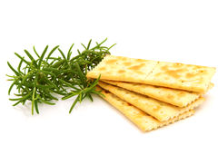 Crackers with rosemary. On the white Royalty Free Stock Photo