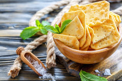 Crackers with salt in a wooden bowl. Stock Photography