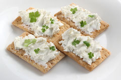 Crackers with sheep cheese Royalty Free Stock Images