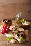 Crackers with soft cheese olives grapes. healthy appetizer Stock Photos