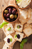 Crackers with soft cheese and olives. healthy appetizer Stock Image