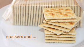 CRACKERS AND - Stack of crispy salted crackers on a plate to be enjoyed plain or with a topping Stock Photo
