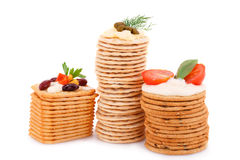Crackers. Stacks with fresh vegetables and cream isolated on white background Stock Photo