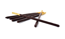 Crackers stick and coated with black chocolate on white. Background Royalty Free Stock Image