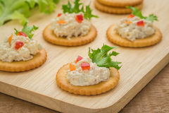 Crackers with tuna salad on wooden plate Royalty Free Stock Images