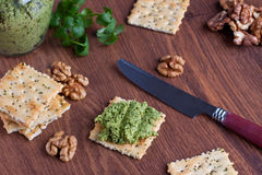 Crackers with walnut pesto Stock Photos