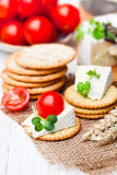 Crackers  and wedge of blue camembert cheese on sackcloth napkin Stock Photography