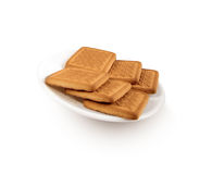 Crackers on white plate Stock Images