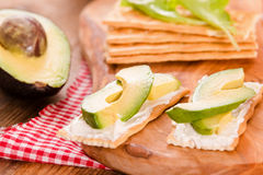 Crackers With Ham And Avocado. Stock Images