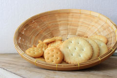 Crackers in wooden basket Stock Photography
