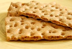 Crackers on wooden plate Stock Image