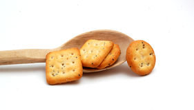 Crackers on wooden spoon. Pic of crackers on wooden spoon Royalty Free Stock Photo