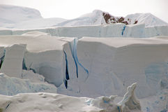Cracking Antarctic glacier. An antarctic glacier carving under the heat of the sun stock image
