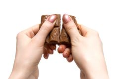 Cracking chocolate Stock Photography