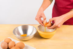 Cracking an egg Stock Photos