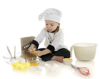 Cracking Eggs Stock Images