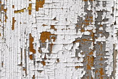 Cracking, flaky paint. Cracked, peeling, flaking paint on an old door Stock Photo