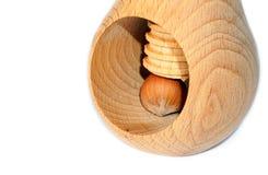 Cracking the hazelnut. In hazelnut cracking machine Stock Image