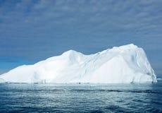 Cracking Iceberg 4. Large iceberg showing crevasses/cracks. off the coast of Greenland royalty free stock image
