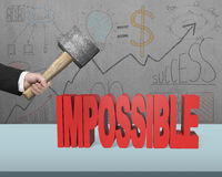 Cracking impossible 3D word on desk. In office Stock Photography