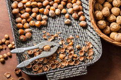 Cracking nuts hazelnuts in wicker basket Stock Photo