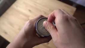 Cracking open a can of soda or beer, closeup macro view.  stock video footage
