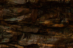 Cracking rocky cliffs. There is water wet rock cliffs texture stock photos