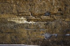 Cracking wall. Old cracking wall with deep relief Stock Image