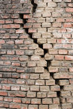 A CRACKING IN A  WALL. TEXTURES OF A BRICK WALL AND A CRACKING  AS BACKGROUNDS Stock Photography