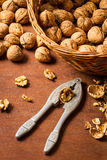 Cracking walnuts Stock Photos