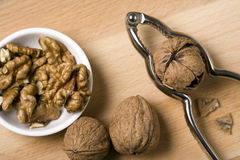 Cracking walnuts Royalty Free Stock Images