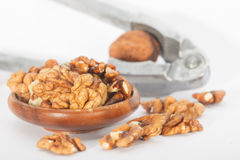 Cracking walnuts with nutcracker Stock Photos